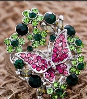 Butterfly ring with green crystals